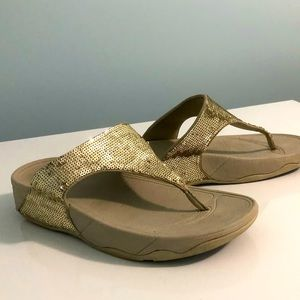 Gold sequinned fit flops